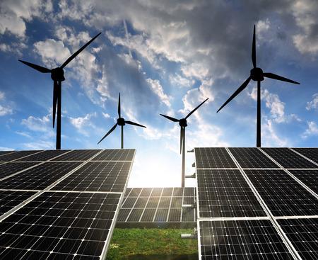 alternativ: Solar energy panels with wind turbines in the setting sun