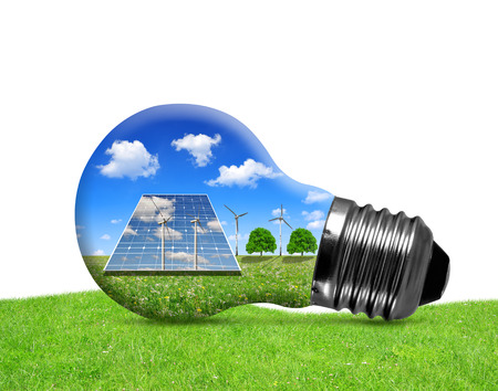 solar wind: Solar panels and wind turbines in light bulb. Green energy concept. Stock Photo