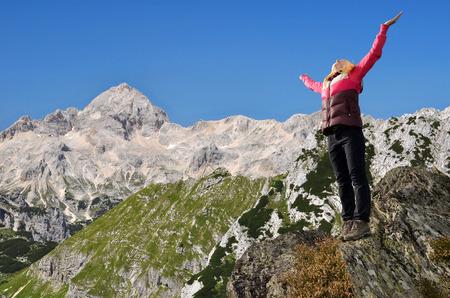 rocky mountain national park: Girl on rock in the background mount Triglav  Julian Alps Slovenia
