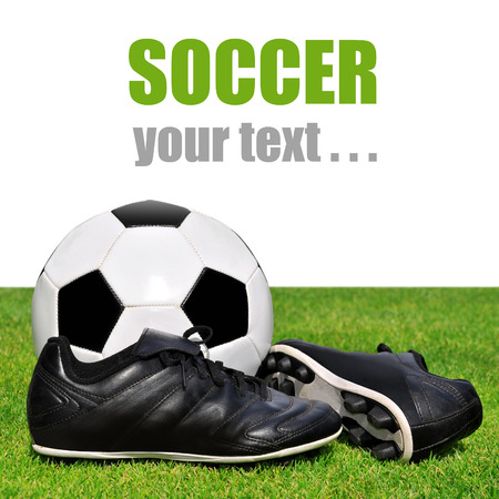 soccer cleats: soccer ball and shoes in grass on white background