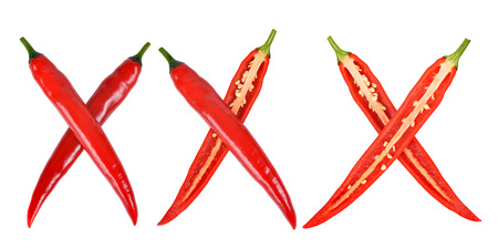 xxx: xxx made from red hot chilli peppers isolated on white