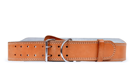 Belt used for strength training or weightlifting isolated on white Imagens