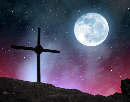universe: Top Cross silhouette in the night sky with moon.