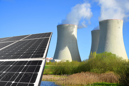 nuclear plant: Solar energy panels and nuclear power plant Stock Photo