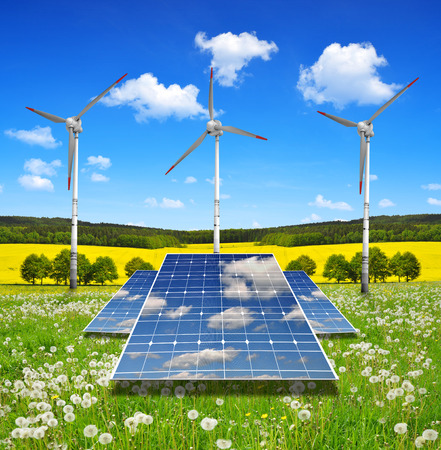 Solar energy panels and wind turbines in spring landscape