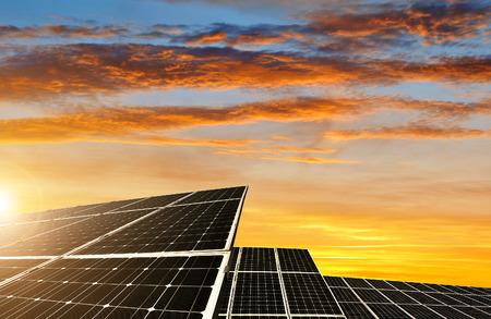 solar industry: Solar energy panels against sunset sky