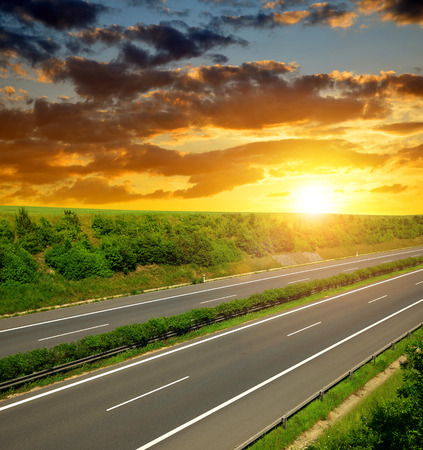 Empty Highway in the sunset Stock Photo