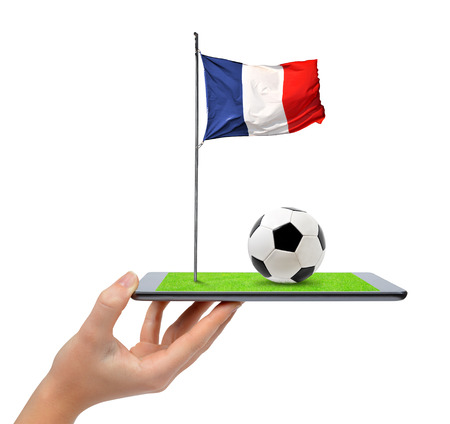 digital tablet: Hand holding digital tablet pc with soccer ball and French flag