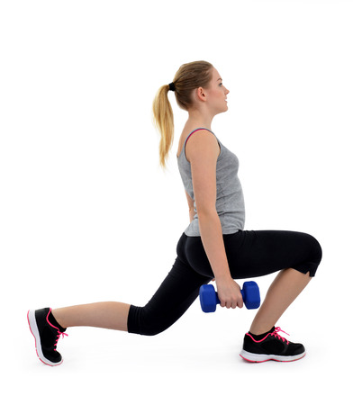 lunges: Girl exercise thighs muscles with dumbbells on white background