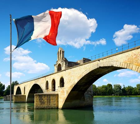 avignon: Pont Saint-Benezet with French flag in Avignon, France