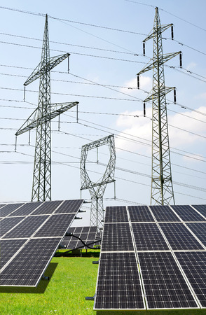 panel: Solar panels with electricity pylons. Green energy concept.