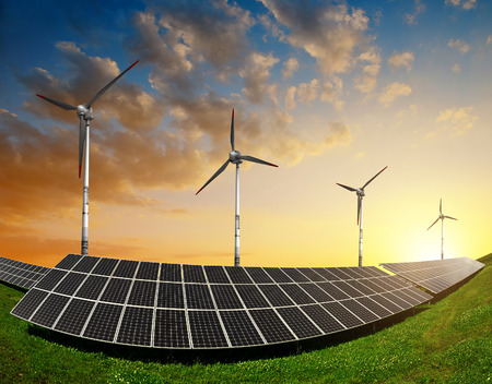 solar wind: Solar panels with wind turbines in the setting sun. Concept of energy resources.