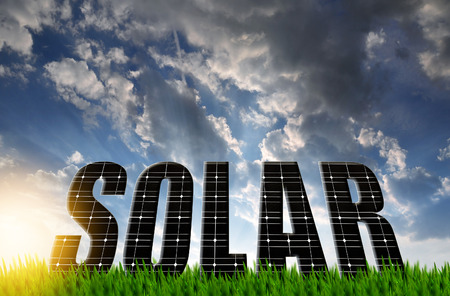The word Solar from solar energy panels against sunset sky Stock Photo