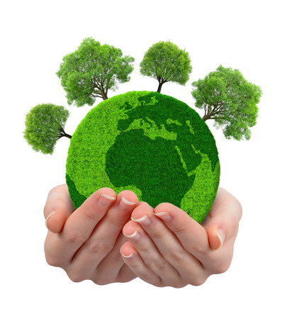 Groene planeet met bomen in handen op een witte achtergrond Stockfoto