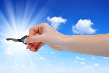 hand key: Hand with key