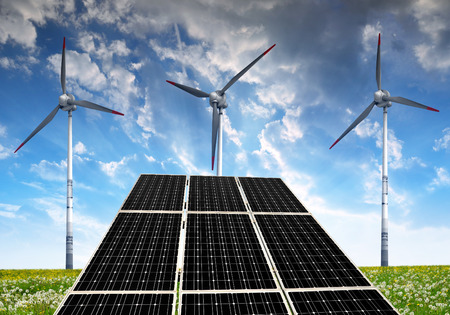 wind: Solar panels with wind turbines in the setting sun Stock Photo