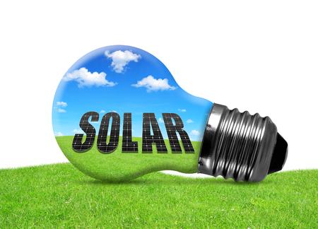 alternativ: Eco light bulb in grass. Green energy concept. Stock Photo
