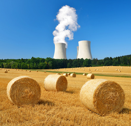 tower: Bales of straw on the field in the background cooling tower nuclear power plant