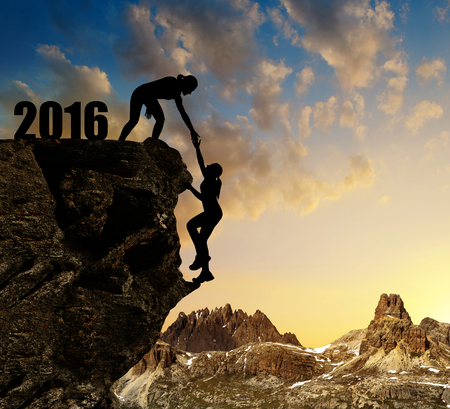mountain sunset: Silhouette girls climbs into the New Year 2016.