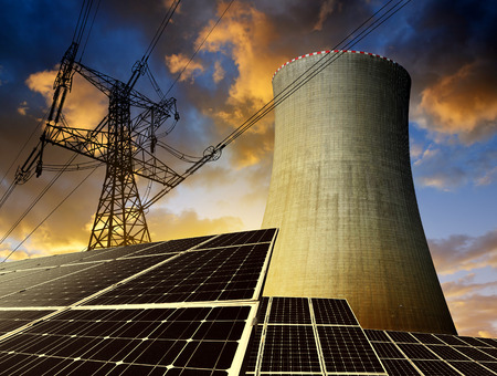 outdoor electricity: Solar energy panels, nuclear power plant and electricity pylon at sunset Stock Photo