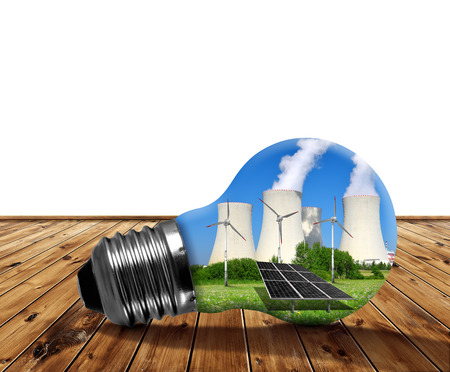 alternativ: Nuclear power plant with solar panel and wind turbines in lightbulb. Energy resources concept. Stock Photo