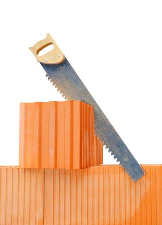 redbrick: Diamond handsaw on bricks. Bricklaying work.
