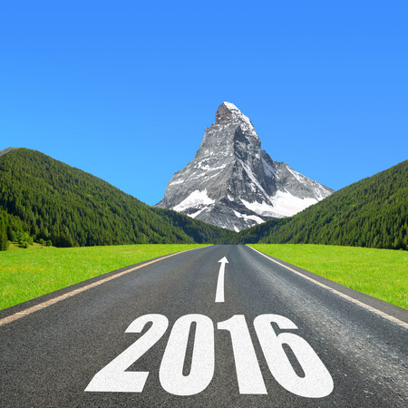 road sign highway sign: Asphalted road in mountain landscape. Forward to the New Year 2016
