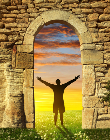 new path: A man standing at the gate to paradise. Entrance to new life.