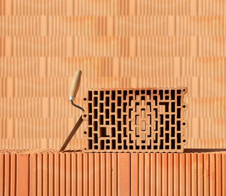 redbrick: Building a brick wall. Bricklaying work. Stock Photo