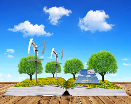 ahorro energia: libro ecológico con las turbinas de paneles solares y de viento. concepto de energía limpia. Foto de archivo