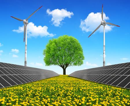 Solar energy panels and wind turbines on dandelion field. Clean energy.