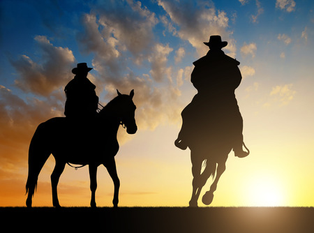 cowboy: Silhouette cowboy with horse in the sunset