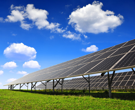 silicium: Solar panels against blue sky with clouds Stock Photo