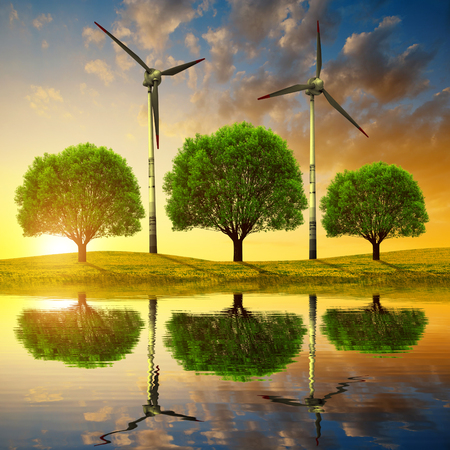 renewable energy: Trees with wind turbines on meadow at sunset. Spring landscape Stock Photo