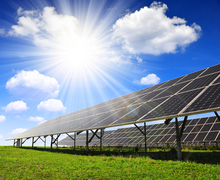 solar power plant: Solar energy panels with sunny sky Stock Photo