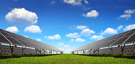 silicium: Solar energy panels against blue sky with clouds. Clean energy.