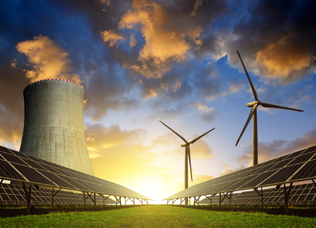 wind power plant: Solar energy panels, wind turbines and nuclear power plant at sunset. Stock Photo
