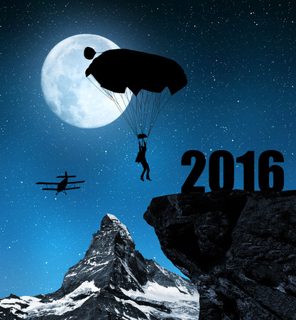 matterhorn: Silhouette skydiver parachutist landing in to the New Year 2016 in night.