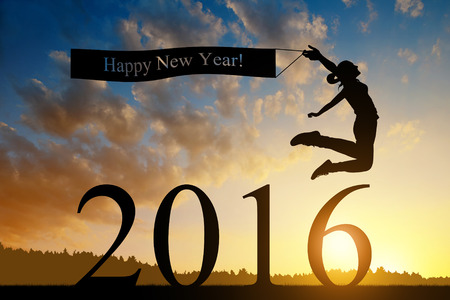 year's eve: Girl jumps to the New Year 2016 at sunset Stock Photo