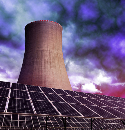 alternativ: Solar energy panels with nuclear power plant against storm clouds