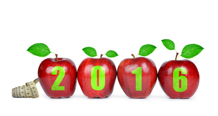 apple green: Red apples with measuring tape. Healthy resolutions for the New Year 2016 Stock Photo