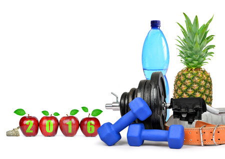eat healthy: Fruit, dumbbells and PET bottle with drinking water. Healthy resolutions for the New Year 2016 Stock Photo