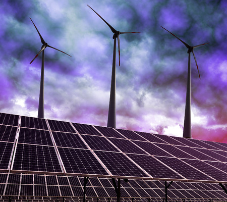 alternativ: Solar energy panels and wind turbines against storm clouds. Clean energy.