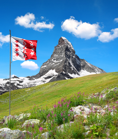 valais: Beautiful mount Matterhorn with Valais flag . Switzerland. Stock Photo