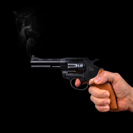 holding gun: Hand holding gun isolated on black background Stock Photo