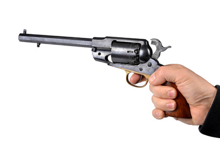 colt: Hand holding percussion revolver isolated on white background
