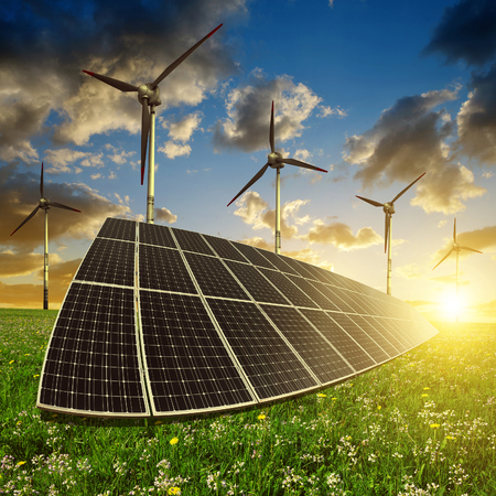 alternativ: Solar panels with wind turbines in the setting sun. Concept of energy resources Stock Photo