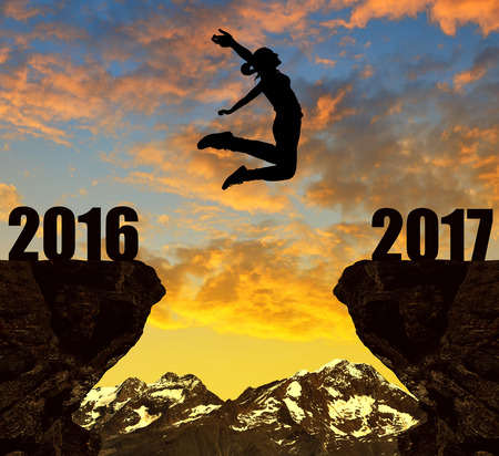 Girl jumps to the New Year 2017 at sunset.