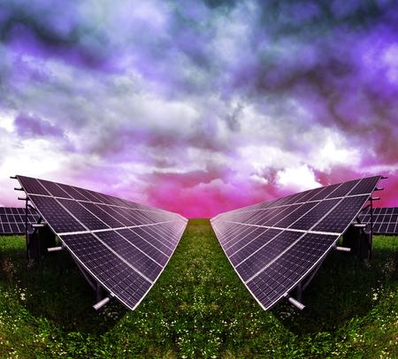 alternativ: Solar energy panels against storm clouds. Clean energy.