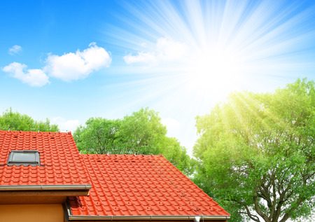 Roof house with tiled roof. Stock Photo